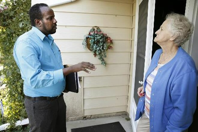 Abdul Kulane, a Somali-American running for the St. Cloud City Council seat in Ward 1, talks with Gloria Jones, 72, at her home in St. Cloud on Wednesday, September 17, 2014.  Photo: Leila Navidi