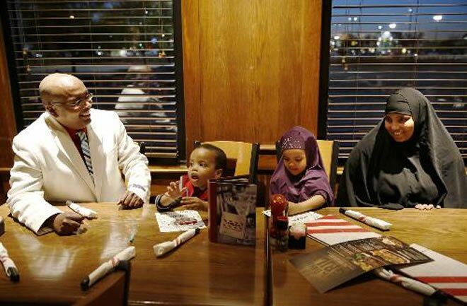 Ahmed Ali Said, a Somali-American running for the Ward 3 city council seat in St. Cloud, Minn. sits down to dinner with his family at TGI Fridays in St. Cloud on Wednesday, September 17, 2014. From left is Ahmed Ali Said, his son Suhayb Ali, 2, daughter...  Photo: Leila Navidi