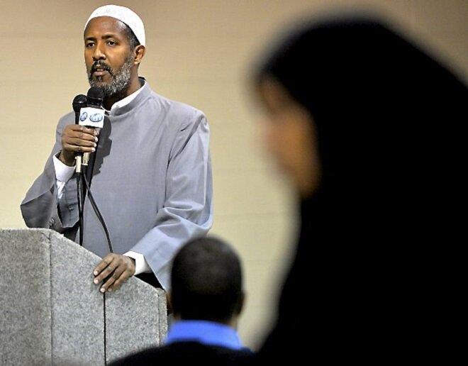 Abdisalam Adam, a teacher in St. Paul and imam at Dar al-Hijrah mosque in Minneapolis, speaks at a memorial Saturday, Nov. 22, 2014, for Abdullahi Ali Anshoor at the Afton View Apartments in St. Paul. Anshoor, 64, of Brooklyn Park, was killed by militants in his native Somalia last week after returning to help rebuild Mogadishu. (Pioneer Press: Sherri LaRose-Chiglo)