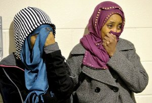Two women wipe away tears during a gathering to honor Adullahi Anshoor,64, of Brooklyn Park, who was killed in his native Somalia after returning to his homeland to help rebuilt it and was fatally shot on November 17, 2014. Residents of Afton Alps Apartments gathered to honor the man who worked there over a decade. These women asked to not be indentified. (Pioneer Press: Sherri LaRose-Chiglo)